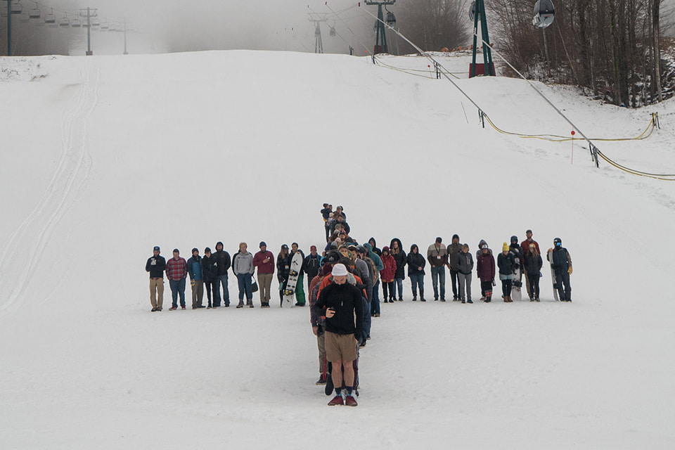 Backcountry skiers and snowboarders heading uphill