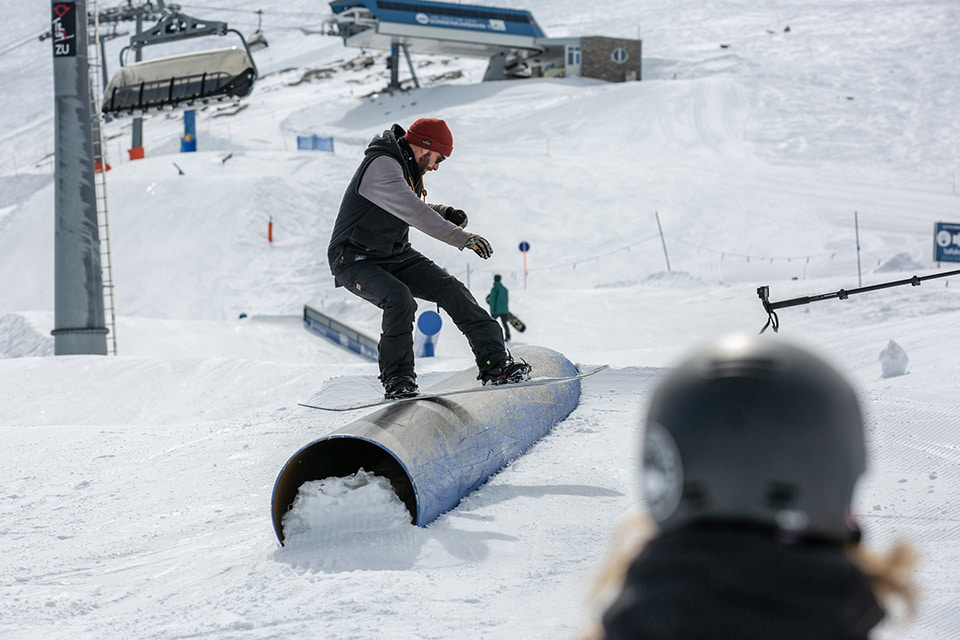 Snowboarder for Christ sliding on a tube